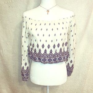 blouse detailed with an off-the-shoulder neckline
